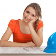 Female architect reading blueprints - Stock Photo