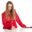 Writes woman in red pajamas — Foto Stock