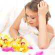 Woman with orchid and feathers — Stock Photo