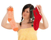 Young woman with socks — Stock Photo