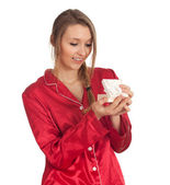 Woman in pajamas with gift box — Stock Photo