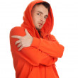 Man in orange sweatshirt — Stock Photo