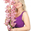 Royalty-Free Stock Photo: Young woman with orchid