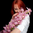 Stock Photo: Young woman with orchid
