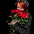 Winter woman with roses — Stock Photo