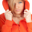 Woman in orange sweatshirt and hood - Stock Photo
