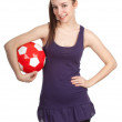Young woman with red ball — Foto Stock