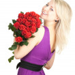 Young woman with roses - Foto Stock