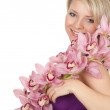 Stock Photo: Young womwith orchid