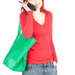 Calling woman and shopping bag — Stock Photo