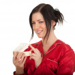 Woman in pajamas with gift box - Foto Stock