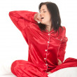 Woman in red pajamas — Stock Photo