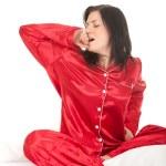 Woman in red pajamas — Stock Photo