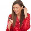 Woman in red pajamas with phone - Foto Stock