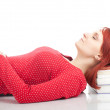Sleeping woman on pile books - Stock Photo