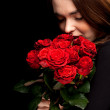 Foto Stock: Lovely woman with red roses