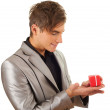Young man with gift box — Stock Photo
