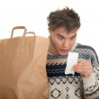 Surprised man with store receipt — Stock Photo #4877459