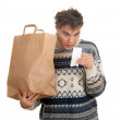 Surprised man with store receipt - Stockfoto