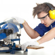 Man with saw preparing for cutting — Foto Stock
