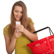 Woman with purchases list - Stock Photo