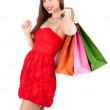 Young woman & coloured bags - Stock Photo