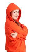 Woman in orange sweatshirt and hood — Stock Photo