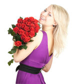 Young woman with roses — Stock Photo