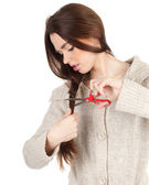 Young woman with a scissors — Stock Photo