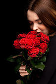 Lovely woman with red roses — Stok fotoğraf