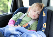 Sleeping child in car seat — Stock Photo