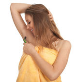 Woman shaving underarm with razor — Stock Photo