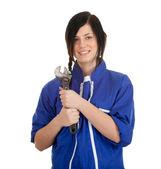 Vrouw in overall met gereedschap — Stockfoto