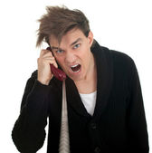 Angry young man and phone — Stock Photo