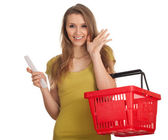 Woman with purchases list — Stock Photo