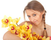 Dreaming woman with orchid — Stock Photo