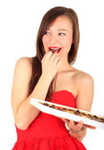 Young woman with chocolate box — Stock Photo