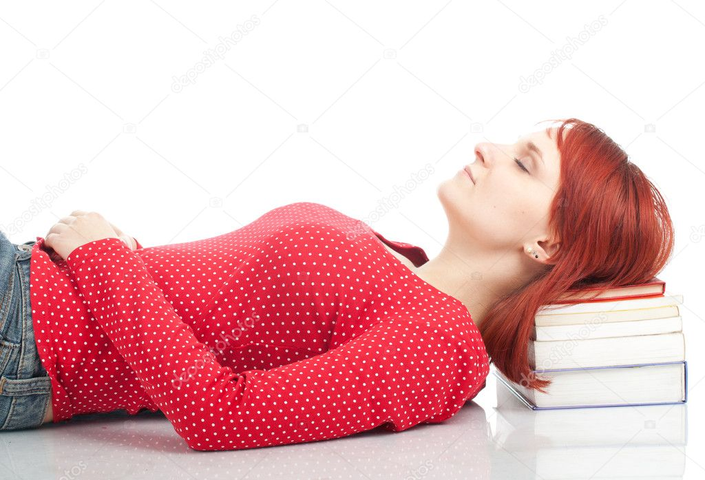 Young woman sleeping on the stack of books — Stock Photo #4875309