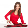 Stock Photo: Ironing young woman