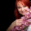 Young woman with orchid - 图库照片