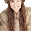 Stock Photo: Woman in a fur coat and hat