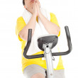 Overweight woman on fitness bicycle — Stock Photo #4954233