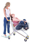 Mannequin with woman in shopping cart — Stock Photo