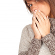 Frightened woman in grey sweater — Stock Photo