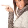 zeigt Frau im grauen Pullover — Stockfoto