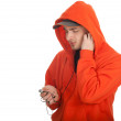 Man in orange sweatshirt with MP3 - Stock Photo