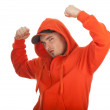 Man in orange sweatshirt — Stock Photo #5048440