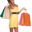 Young woman & coloured shopping bags — Stock Photo #5048633