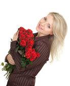 Junge frau mit rosen — Stockfoto