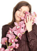 Young woman with orchid — Stock Photo